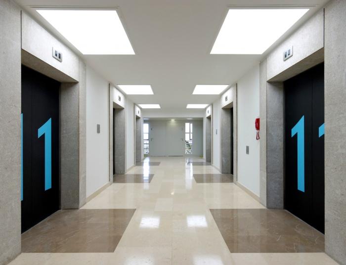 TOUR DE BUREAUX À NANTERRE - RÉHABILITATION D'UN IGH : Hall ascenseurs
